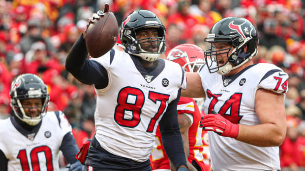 Houston Texans tight end Darren Fells is congratulated by tackle Max Scharping after scoring a touchdown against the Kansas City Chiefs during the first half in a AFC Divisional Round playoff football game at Arrowhead Stadium.