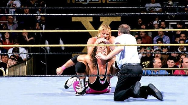 Bret and Owen Hart wrestle in the ring during WWE's WrestleMania X