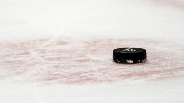 Closeup view of hockey puck laying on the ice