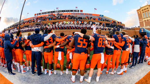 The Illinois Fighting Illini celebrate after a victory over the Rutgers Scarlet Knights at Memorial Stadium.