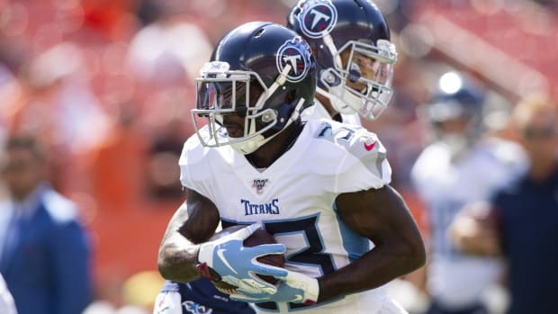 Tennessee Titans running back Dion Lewis (33) runs the ball during warmups before a game against the Cleveland Browns at FirstEnergy Stadium.