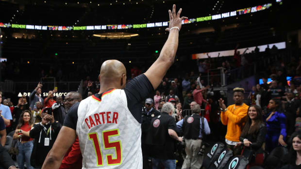 Hawks' Vince Carter walks off the court after news that the NBA is suspending its season over the coronavirus