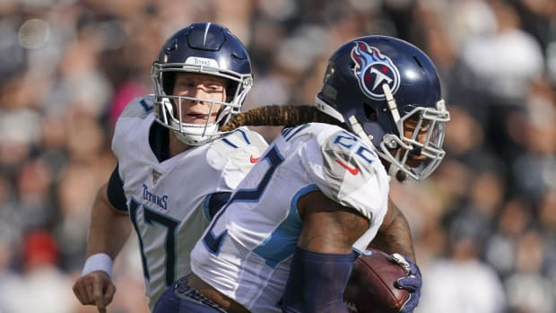 Tennessee Titans quarterback Ryan Tannehill (17) hands the football off to running back Derrick Henry (22) during the first quarter against the Oakland Raiders at Oakland Coliseum.