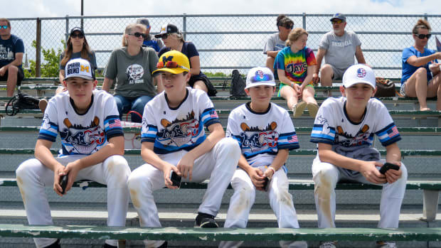 Members of a youth team from Northville, Michigan watch the Michigan Wolverines practice at Creighton University.