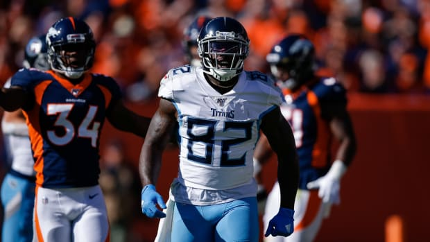 Tennessee Titans tight end Delanie Walker (82) reacts in the first quarter against the Denver Broncos at Empower Field at Mile High.