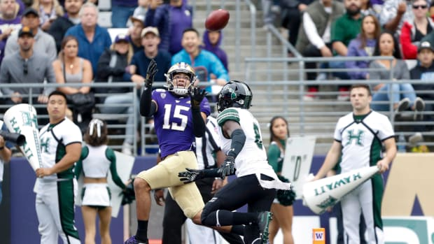 Washington wide receiver Puka Nacua hauls in a 28-yard touchdown catch against Hawaii.