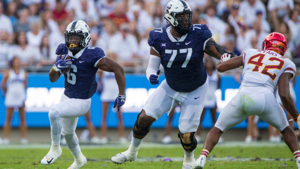 Sep 29, 2018; Fort Worth, TX, USA; TCU Horned Frogs running back Darius Anderson (6) and offensive tackle Lucas Niang (77) in action during the game against the Iowa State Cyclones at Amon G. Carter Stadium.