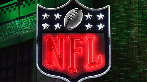 Apr 25, 2019; Nashville, TN, USA; Detailed view of neon NFL shield logo during the first round of the 2019 NFL Draft in downtown Nashville.