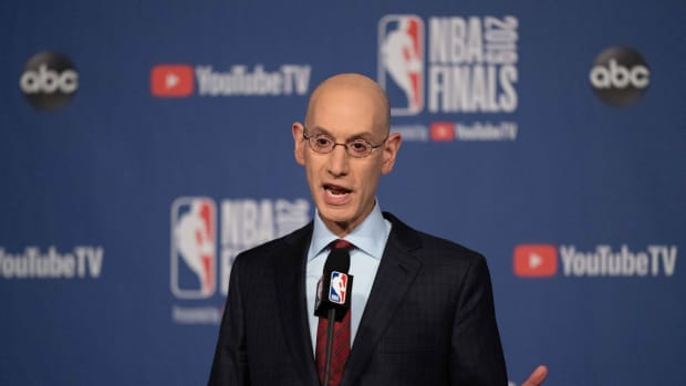 NBA commissioner Adam Silver speaks with reporters prior to a Finals game between the Warriors and Raptors.