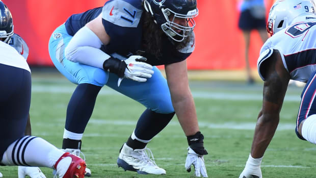 Tennessee Titans offensive tackle Dennis Kelly (71) lines up against the New England Patriots defense during the first half of the preseason game at Nissan Stadium.