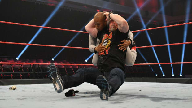 """Steve Austin performs a """"Stone Cold Stunner"""" on Byron Saxton in the ring on WWE Raw"""