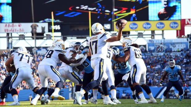 Los Angeles Chargers quarterback Philip Rivers (17) attempts a pass during the first half against the Tennessee Titans at Nissan Stadium.