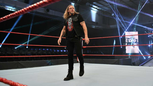 WWE's Edge prepares to deliver a promo in the ring on Raw in an empty WWE Performance Center