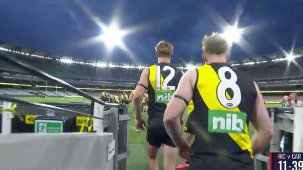 Australian Football League's Richmond Tigers enter the field in an empty stadium for AFL Round One