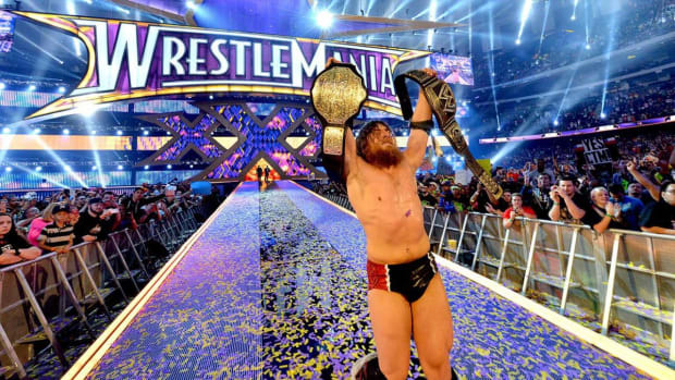 Daniel Bryan celebrates after winning the WWE world title at WrestleMania 30