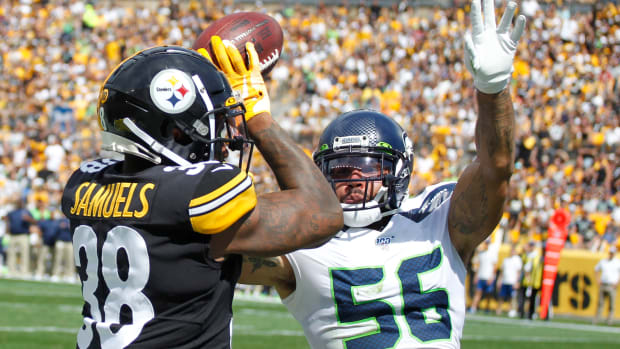Seattle Seahawks linebacker Mychal Kendricks (56) committs pass interference against Pittsburgh Steelers running back Jaylen Samuels (38) during the second quarter at Heinz Field.