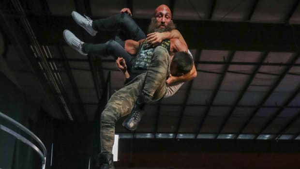 Tommaso Ciampa suplexes Johnny Gargano off the stage on NXT