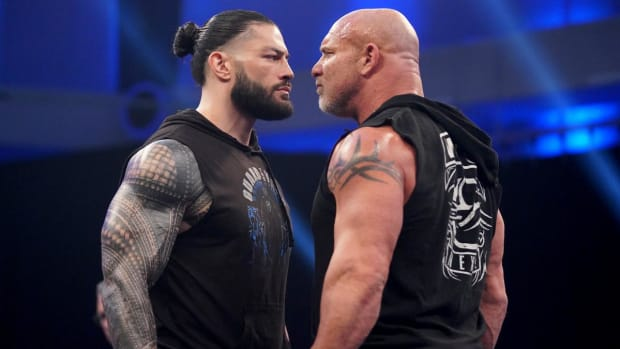 Roman Reigns and Bill Goldberg go face to face in the WWE ring on SmackDown