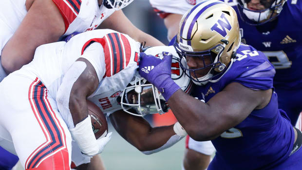 Levi Onwuzurike, shown tackle Utah's Zach Moss, has been the player Washington envisioned all along.