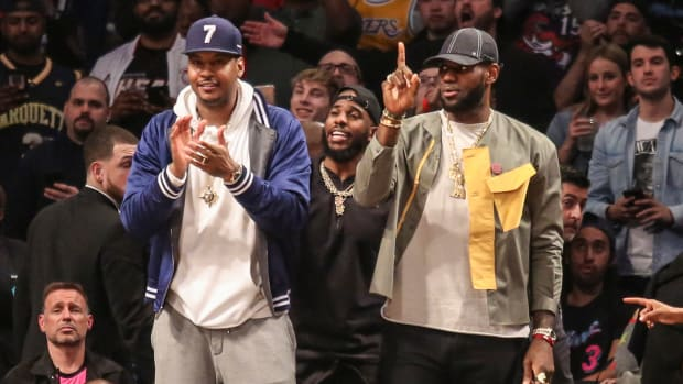 Carmelo Anthony on the sideline and Dwyane Wade's final game