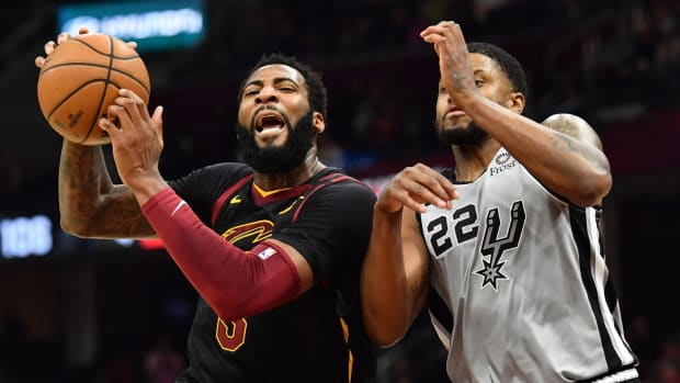 Cleveland Cavaliers center Andre Drummond drives to the basket against San Antonio Spurs forward Rudy Gay during a game at Rocket Mortgage FieldHouse.