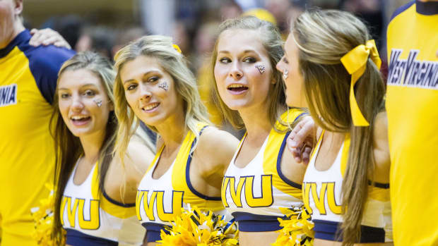 West Virginia Mountaineers cheerleaders celebrate after beating the Mississippi Valley State Delta Devils at WVU Coliseum.