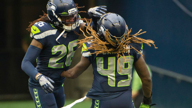 Seattle Seahawks cornerback Shaquill Griffin (26) celebrates with his brother outside linebacker Shaquem Griffin (49) after a defensive stop during the first half against the Denver Broncos at CenturyLink Field.