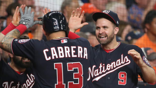 Nationals' Brian Dozier celebrates with Asdrubal Cabrera during the 2019 World Series