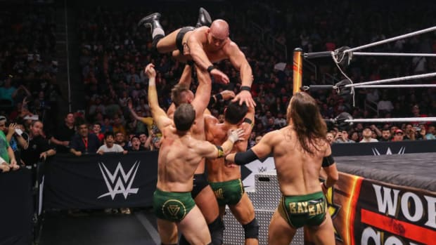 WWE's Fabian Aichner dives outside the ring against the Undisputed Era at Worlds Collide