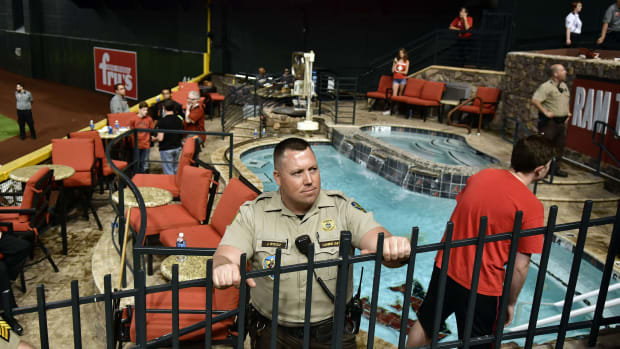 Oct 9, 2017; Phoenix, AZ, USA; Police and venue security guard the pool area following the Los Angeles Dodgers victory against the Arizona Diamondbacks in game three of the 2017 NLDS playoff baseball series at Chase Field. Mandatory Credit: Matt Kartozian-USA TODAY Sports