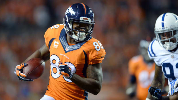 Denver Broncos wide receiver Demaryius Thomas (88) runs after a reception in the fourth quarter against the Indianapolis Colts at Sports Authority Field at Mile High. The Broncos defeated the Colts 31-24.