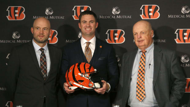 Feb 5, 2019; Cincinnati, OH, USA; Cincinnati Bengals head football coach Zac Taylor (middle) poses for photo alongside Bengals owner Mike Brown (right) and Duke Tobin , Bengals director of player personnel at the end of a press conference at Paul Brown Stadium. Mandatory Credit: David Kohl-USA TODAY Sport