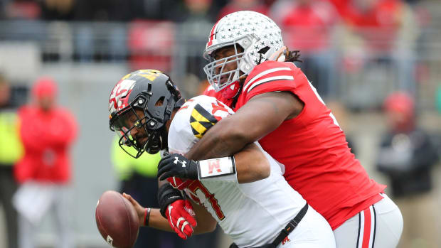 Ohio State Buckeyes defensive tackle Davon Hamilton (53) sacks Maryland Terrapins quarterback Josh Jackson (17) during the first quarter at Ohio Stadium.