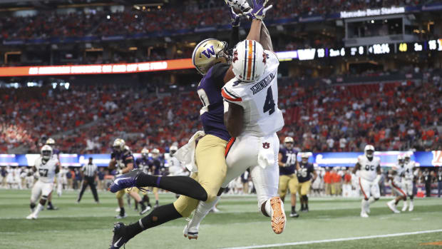 Auburn Tigers defensive back Noah Igbinoghene (4) deflects a pass intended for Washington Huskies wide receiver Ty Jones (20) in the third quarter at Mercedes-Benz Stadium.