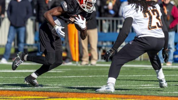 South wide receiver Van Jefferson of Florida (14) runs against safety Kyle Dugger of Lenoir Rhyne (23) during Senior Bowl practice at Ladd-Peebles Stadium.