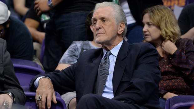 Miami Heat president Pat Riley watches a game between the Heat and Phoenix Suns at Talking Stick Resort Arena.
