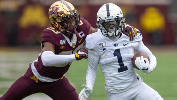 Penn State Nittany Lions wide receiver KJ Hamler (1) rushes with the ball past Minnesota Golden Gophers defensive back Jordan Howden (23) in the second half at TCF Bank Stadium.