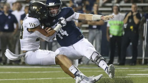 Wake Forest Demon Deacons linebacker Justin Strnad (23) sacks Rice Owls quarterback Tom Stewart (14) for a three yard loss on the one yard line in the fourth quarter at Rice Stadium.