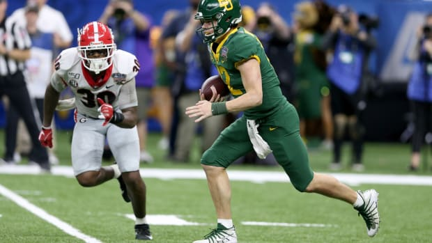 Jan 1, 2020; New Orleans, Louisiana, USA; Baylor Bears quarterback Charlie Brewer (12) runs from pressure by the Georgia Bulldogs linebacker Tae Crowder (30) in the second half of the Sugar Bowl at the Mercedes-Benz Superdome.
