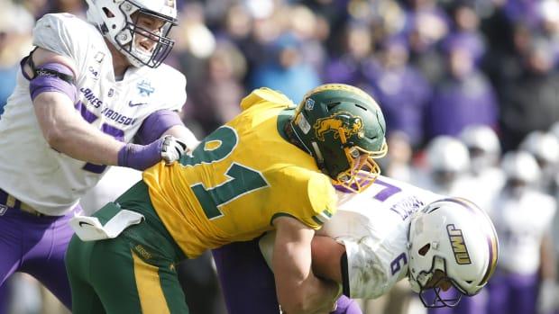 North Dakota State Bison defensive end Derrek Tuszka (91) sacks James Madison Dukes quarterback Ben DiNucci (6) in the fourth quarter at Toyota Stadium.