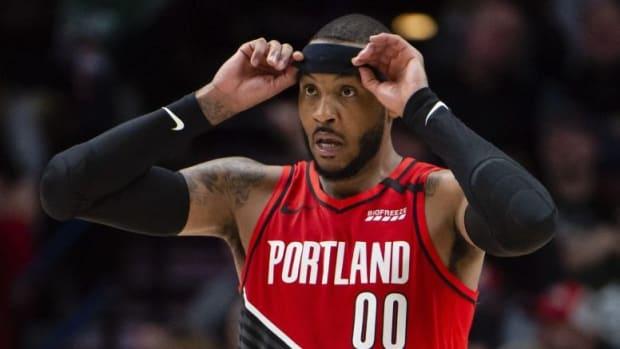 Portland Trail Blazers forward Carmelo Anthony adjusts his headband during a game vs. the Boston Celtics.