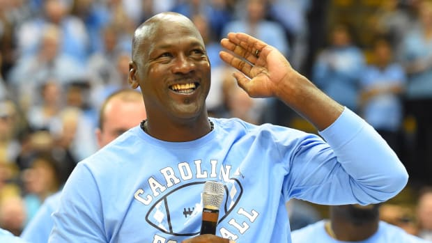 Michael Jordan speaks at a North Carolina basketball game