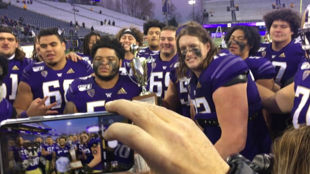Nate Kalepo stands at the very back of this collection of Washington offensive line, waiting his turn.