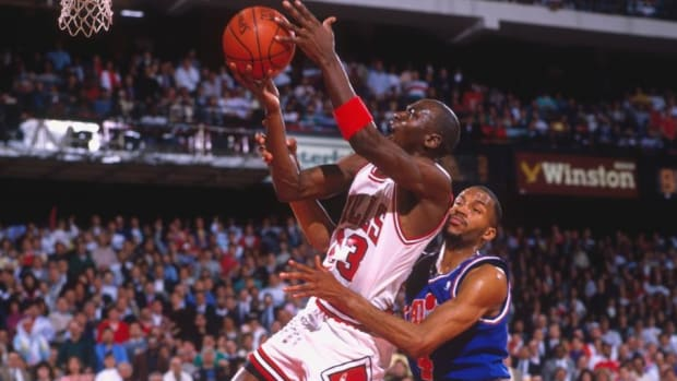 Chicago Bulls legend Michael Jordan drives to the basket vs. Ron Harper and the Cleveland Cavaliers in 1989.