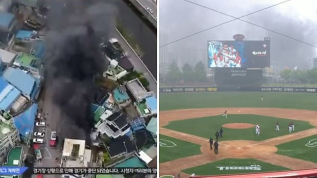 Screenshots from broadcast of KBO game showing fire delaying play