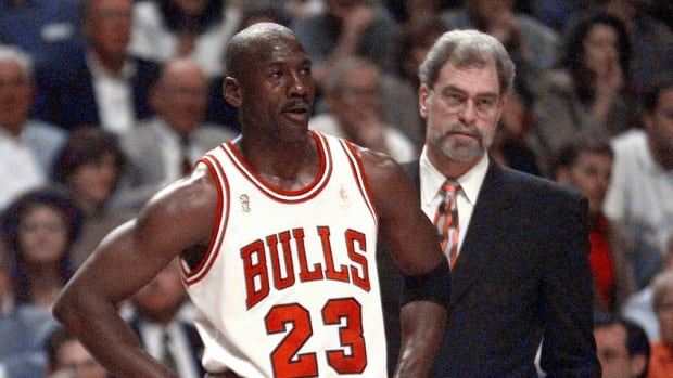 Michael Jordan and Phil Jackson on the sideline during a Chicago Bulls game in the 1990s