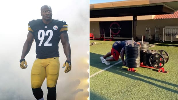 Former Steelers linebacker James Harrison pushes a sled weighing 1,960 pounds.