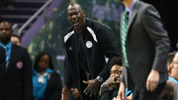 Charlotte Hornets owner Michael Jordan on the sideline during a game, yelling