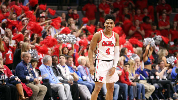 Mississippi Rebels guard Breein Tyree (4) smiles as fans cheer prior to a game against the Missouri Tigers at The Pavilion at Ole Miss. Mandatory Credit: Petre Thomas-USA TODAY Sports