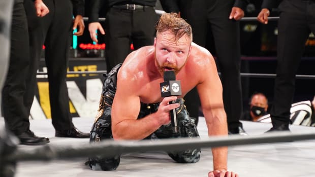 AEW's Jon Moxley in the ring after being attacked by The Dark Order